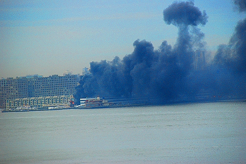NY-NJ- 2 Boats burn in Weehawken Harbor, New jersey